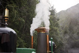 Steam Emitted From The Engine Of An Old Steam Train - 197288375