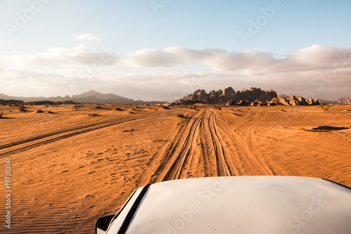Fotobehang Oranje eclat The view from the body of the jeep on beautiful views of sand and large rocks in the Wadi rum desert in Jordan on a evening
