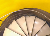 part of the spiral staircase in a public building