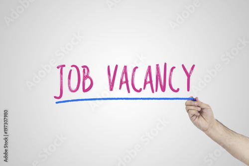 Human's hand writing Job vacancy on whiteboard.