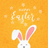 Orange background with pattern and text Happy Easter with rabbit ears