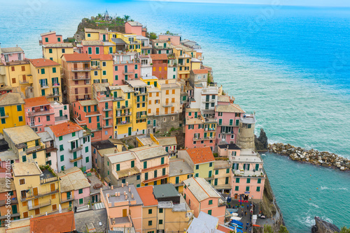 Fotobehang Liguria The small traditional Italian village of Manarola with colorful houses now a popular tourist destination in Cinque terre, Liguria, Italy