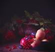 яблоки сливы и калина лежат на столе натюрморт