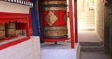 Traditional art and culture in Buddhist temple decoration. Spinning prayer wheel in Ladakh monastery in India - 197323738