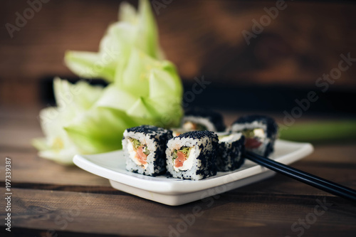sushi, food, japanese, meal, rice, fish, roll, plate, dinner, seafood, gourmet, salmon, cuisine, japan, maki, asia, restaurant, lunch, seaweed, white, traditional, raw, healthy, dish, delicious - 197339387