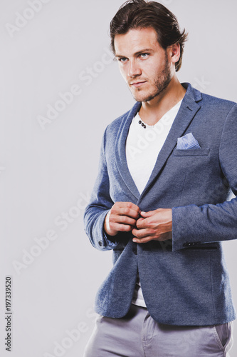 caucasian man wearing blue jacket white shirt and trendy hairstyle - 197339520
