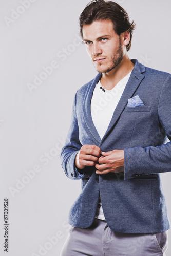 Foto op Plexiglas Kapsalon caucasian man wearing blue jacket white shirt and trendy hairstyle