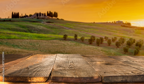 Fotobehang Wijngaard wooden planks with Italian landscape on background. Ideal for product placement