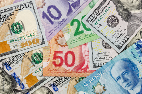 Canadian And American Dollar As Background