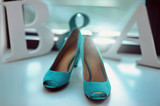 Blue turquoise color wedding bridal details at the window leather high heel shoes - 197342951