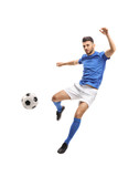 Male soccer player kicking a football in mid-air
