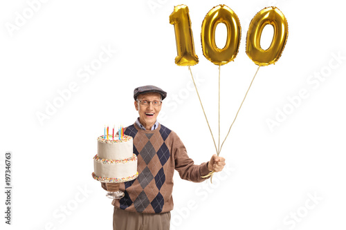 Happy senior with a birthday cake and a number hundred balloon