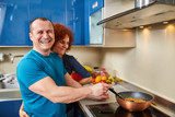 Happy couple cooking at home - 197347527