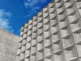Concrete walls under blue sky. 3d