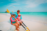 happy mother with kids kayaking at beach - 197353101