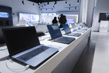 Laptops in a modern technology store. Department of computers in the electronics store. Choosing a laptop in the store - 197354555