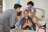 Friends with cake celebrating birthday at a party in room. - 197358193