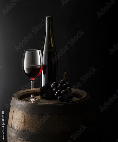 still life with red wine on dark background