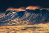 lonely big wave breaking at sunset - 197370500
