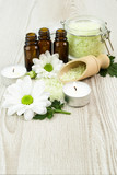 Spa still life with blossoms of chrysanthemum white and essential oils. - 197393128