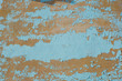 Multicolored peeling blue wall texture and background. Surface with scratches. empty template