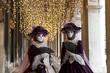 Couple of carnival masks in St. Mark's Square in Venice. Italy