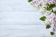 A wooden background with flowering lilac branches