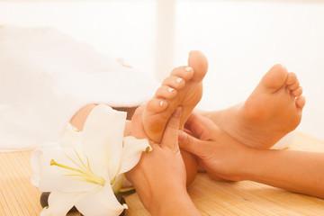 Close-up of female hands doing foot massage © Samo Trebizan