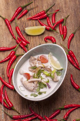 Fotobehang Hot chili peppers thai tom kha gai soup on wood