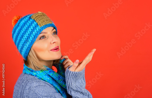 Attractive sensual woman in winter autumn clothes send a kiss. Isolated on red background. Winter fashion. Copy space for advertising. Season sales. Winter, autumn sale. - 197424560