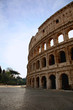 Ancient Roman Coliseum against a blue summer sky