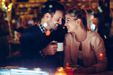 Romantic couple dating in pub at night - 197455770