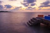 cement bridge at the sea in sunrise time