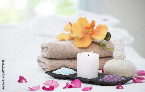 Spa accessories still life with aromatic candle,orchid flower, salt and towel.