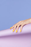 Nails Design. Hands With Bright Yellow Manicure - 197475922