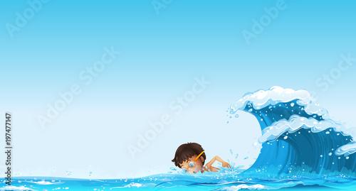 Fotobehang Kids Boy swimming in the ocean