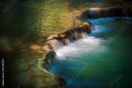 The flowing water representing the free flow of energy and qi, Kuang Si Waterfalls at Luang Prabang, Laos - 197482914