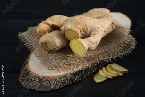 root of fresh ginger on a wooden background