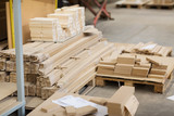 production, manufacture and woodworking industry concept - wooden or medium density fibreboards at workshop