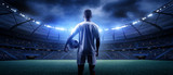 Fototapeta Sport - The football player in the stadium © efks