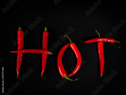 Fotobehang Hot chili peppers Red Hot Peppers on Black Background