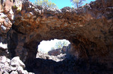 Looking out at the blue sky from a lava tube in the lava badlands of the Mal Pais wildness in Northern New Mexico