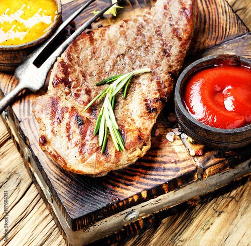 Foto op Plexiglas Steakhouse Beef steak with twig rosemary