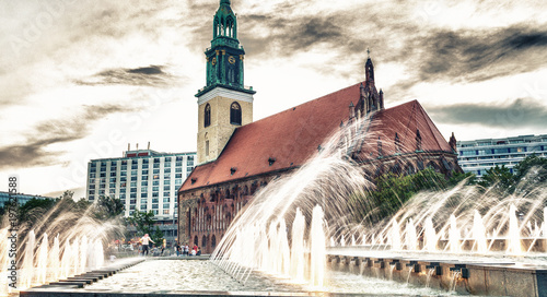 Fotobehang Berlijn BERLIN, GERMANY - JULY 23, 2016: St Mary Church in Alexanderplatz. Berlin attracts 20 million people annually