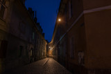 Narrow ancient street of the old city. night photo. Brasov. Romania. Europe.