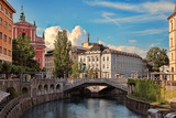 LJUBLJANA, SLOVENIA -  JULY 28, 2017: Old town embankment in Ljubljana. Ljubljana is the business and cultural center of the country. - 197644963