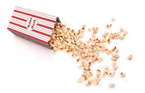 Popcorn is poured from a paper cup on a white background - 197647175