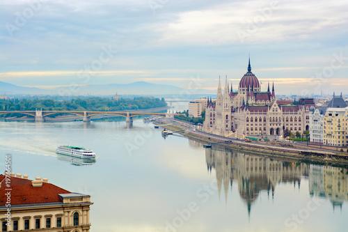Leinwanddruck Bild Quite Danube river, floating cruise ship, Parliament building. Budapest, Hungary