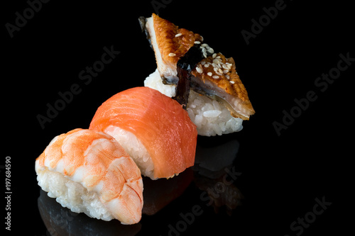 Foto op Plexiglas Sushi bar Set of sushi rolls of fresh fish salmon trout shrimp eel
