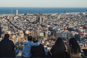 People admiring the views of the city of Barcelona from the antiaerial shelters. We can see in the distance the Sagrada Familia, among other outstanding monuments.